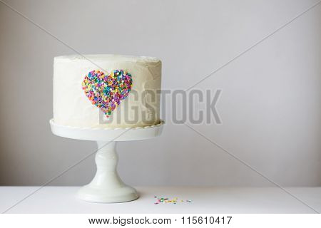 White cake with colorful heart