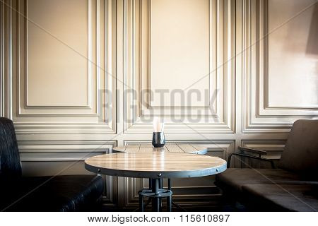 table and sofa and vintage wall room interior