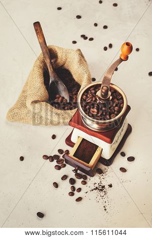 Grinder And A Bag Of Coffee Beans.