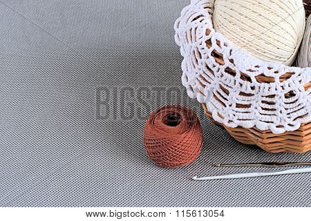 Basket with yarn.