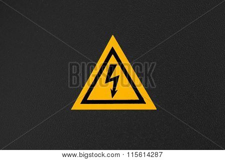 High Voltage Triangle Warning Sign Mounted On Black