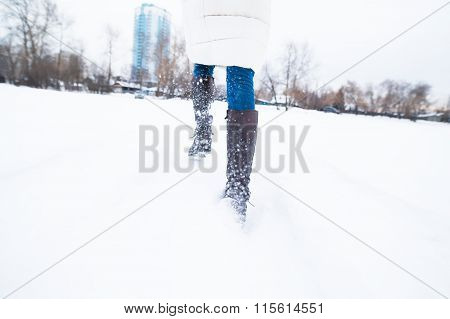 Girl running in the snow, late