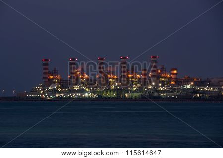 View Of Big Oil Refinery On A Night Sky Background