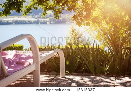 Sunbed At A Beautiful Terrace With Lake View