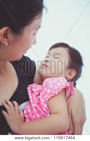 Sleepy Little Asian Child With Mom, Happy Family Concept. Mothers Day Celebration. Vintage Picture S
