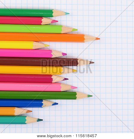 Color Pencils Against A Sheet In Cage