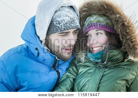 Head and shoulders portrait of happy young couple enjoying of being together