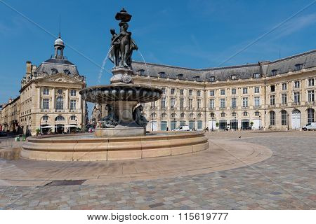 BORDEAUX, FRANCE - JUNE 27, 2013: People walks on the Place de la Bourse in Bordeaux, France on June 27, 2013. The fountain of Three Graces in the center of square was erected in 1869