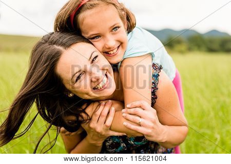 Mother and child hugging