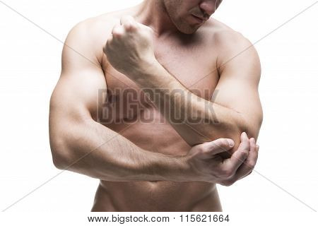 Pain In The Elbow. Muscular Male Body. Isolated On White Background