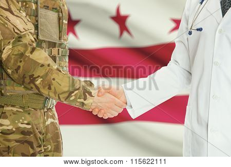 Military Man In Uniform And Doctor Shaking Hands With Us States Flags On Background - District Of Co
