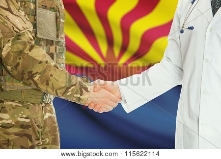 Military Man In Uniform And Doctor Shaking Hands With Us States Flags On Background - Arkansas