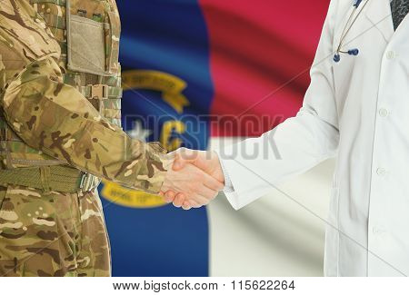 Military Man In Uniform And Doctor Shaking Hands With Us States Flags On Background - North Carolina