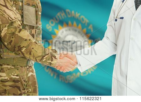 Military Man In Uniform And Doctor Shaking Hands With Us States Flags On Background - South Dakota