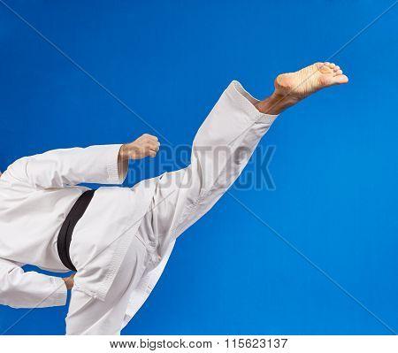 Roundhouse kicks athlete beats with a black belt