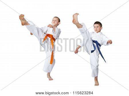 Two athletes in karategi beat kick