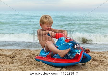 Ukraine Black Sea August 10, 2015: A Boy Playing On The Beach Wi
