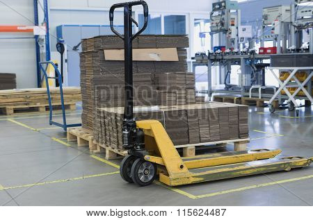 Pallet Truck Is Standing In The Assembly Hall