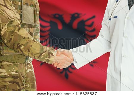 Military Man In Uniform And Doctor Shaking Hands With National Flag On Background - Albania