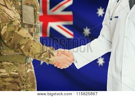 Military Man In Uniform And Doctor Shaking Hands With National Flag On Background - Australia