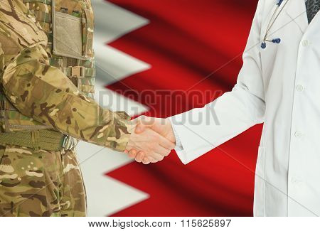 Military Man In Uniform And Doctor Shaking Hands With National Flag On Background - Bahrain