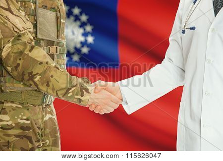 Military Man In Uniform And Doctor Shaking Hands With National Flag On Background - Burma