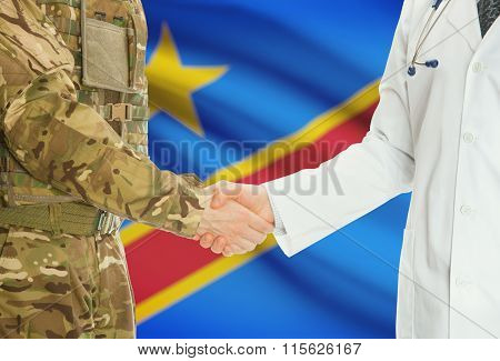 Military Man In Uniform And Doctor Shaking Hands With National Flag On Background - Congo-kinshasa