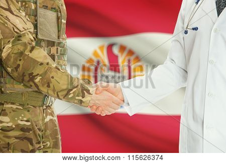 Military Man In Uniform And Doctor Shaking Hands With National Flag On Background - French Polynesia