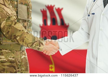 Military Man In Uniform And Doctor Shaking Hands With National Flag On Background - Gibraltar