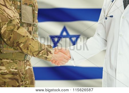 Military Man In Uniform And Doctor Shaking Hands With National Flag On Background - Israel