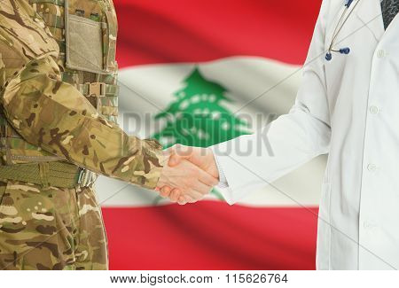 Military Man In Uniform And Doctor Shaking Hands With National Flag On Background - Lebanon