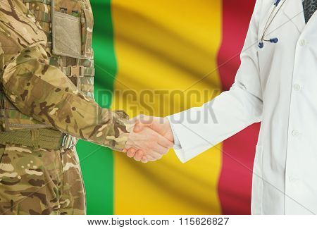 Military Man In Uniform And Doctor Shaking Hands With National Flag On Background - Mali