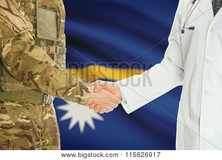 Military Man In Uniform And Doctor Shaking Hands With National Flag On Background - Nauru