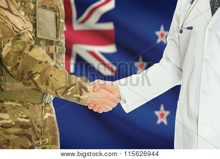 Military Man In Uniform And Doctor Shaking Hands With National Flag On Background - New Zealand