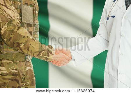 Military Man In Uniform And Doctor Shaking Hands With National Flag On Background - Nigeria