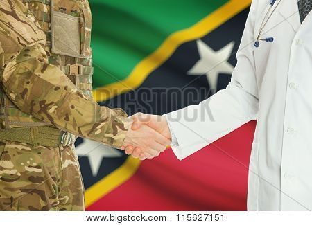 Military Man In Uniform And Doctor Shaking Hands With National Flag On Background - Saint Kitts And