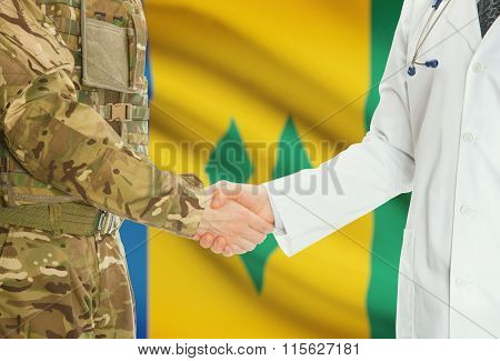 Military Man In Uniform And Doctor Shaking Hands With National Flag On Background - Saint Vincent An