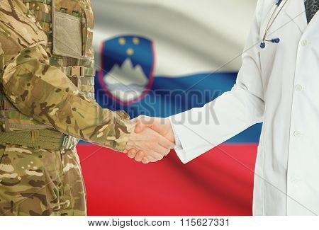 Military Man In Uniform And Doctor Shaking Hands With National Flag On Background - Slovenia