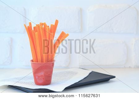 Carrot Slices In A Red Glass