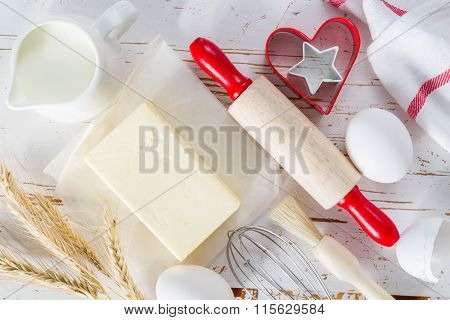 Baking concept with cooking utencils, white wood