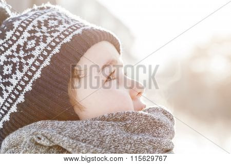 Little boy looking up the sky in winter. Child dreaming, hope concepts.