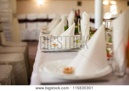 Closeup Of Fine Dinning Tableware And Silverware Catered At Wedding Reception