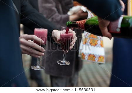 Barmen Pouring Wine Into Glasses For Groom And Guests At Wedding Reception Closeup