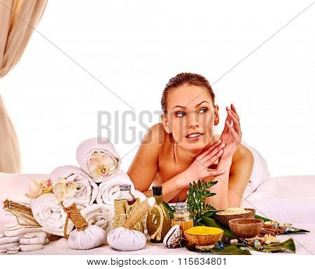 Young woman looking away getting spa treatment on isolated.