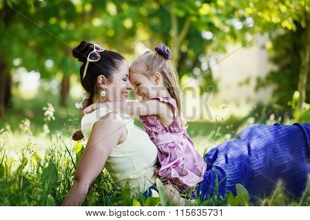 Happy Family. Mother And The Daughter Look At Each Other, Smile,