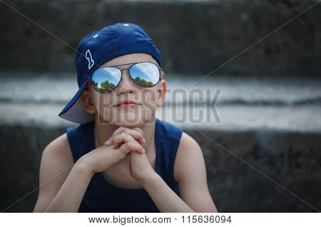 Portrait Of Fashionable Little Boy In Sunglasses And Cap.childho