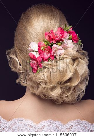 beautiful blond girl  in image of the bride with purple flowers on her head. Beauty face.  Hairstyle