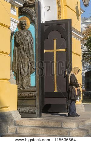 Kiev, Ukraine - September 14, 2015: Woman Enjoys A Gadget At The Threshold Of The Church After The S