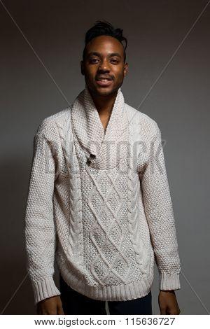 Latin man posing indoor over a grey wall