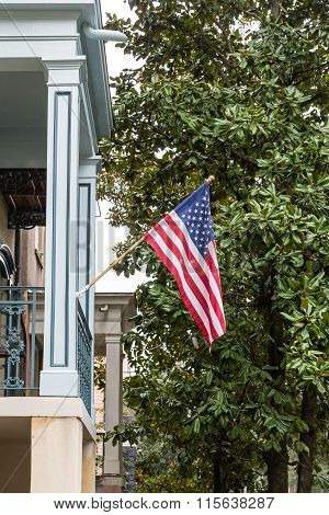 American Flag on Southern Home with Magnolia Tree